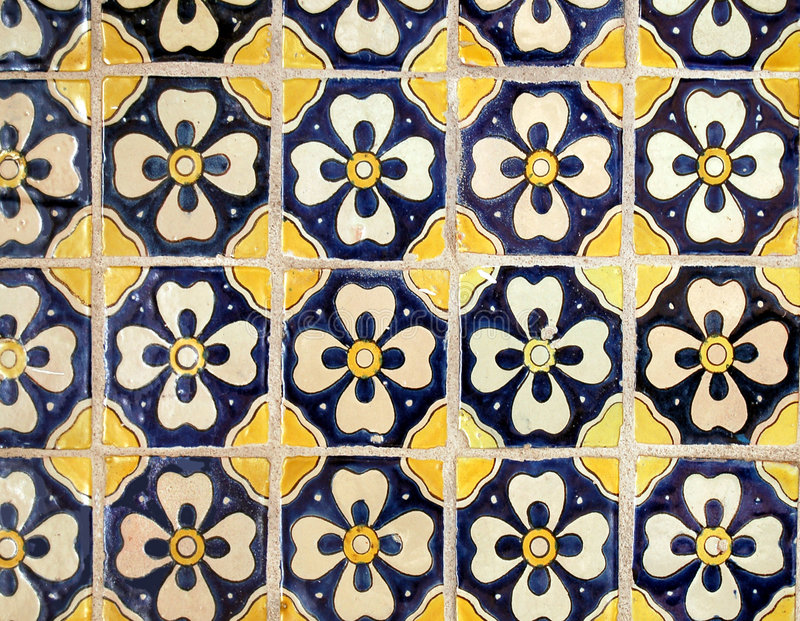 Ancient Tile. Old ceramic tile found outside of a building stock photos