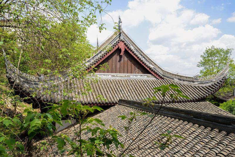 Ancient tile-roofed buildings in trees of sunny spring afternoon. Wufeng town,Chengdu,China royalty free stock photo