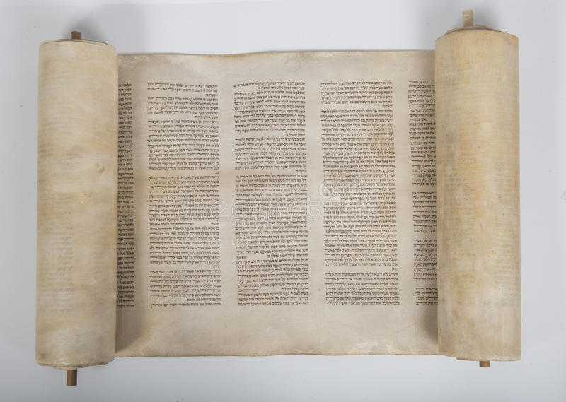 An ancient torah scroll on white background stock photos