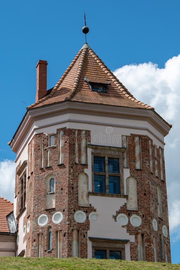 The ancient tower of the Mir castle, historic sites. Mir, Belarus, April 24, 2019: The ancient tower of the Mir castle, historic sites royalty free stock photography