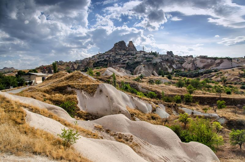 Ancient town and a castle of Uchisar dug from a mountains, Cappadocia, Turkey stock photos