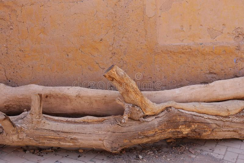 Ancient traditional residential old house wall and dried tree trunk in Tuyoq Village Valley Turpan Xinjiang Province China. Ancient traditional residential old royalty free stock photography