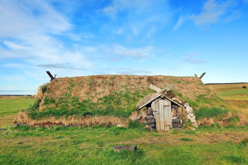 Ancient traditional turf house in Iceland. The common Icelandic turf house would have a large foundation made of flat stones; upon this was built a wooden frame royalty free stock photos