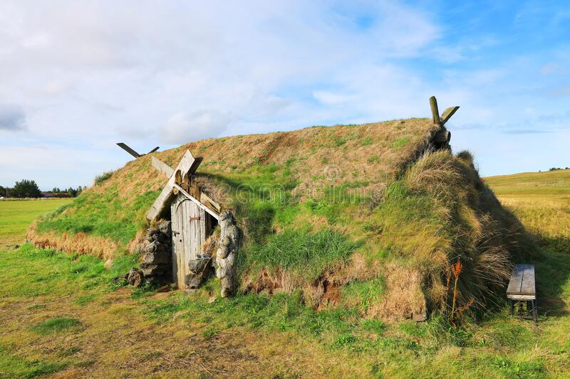 Ancient traditional turf house in Iceland. The common Icelandic turf house would have a large foundation made of flat stones; upon this was built a wooden frame stock image