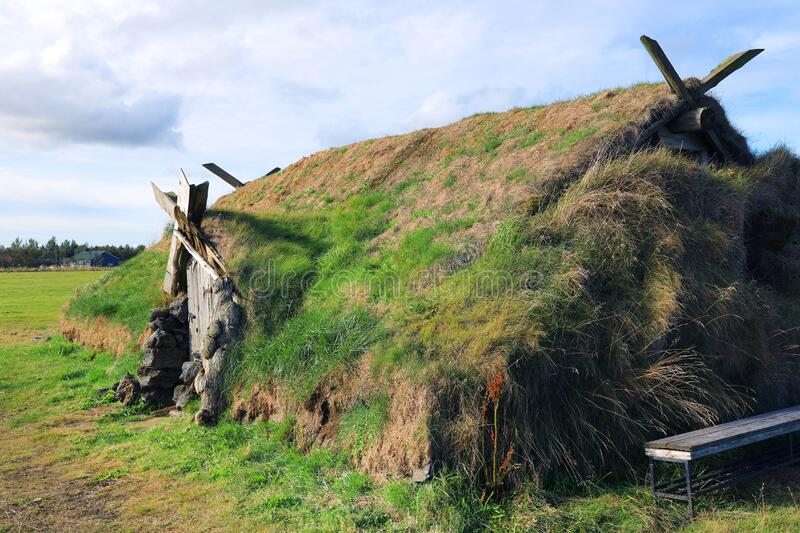Ancient traditional turf house in Iceland. The common Icelandic turf house would have a large foundation made of flat stones; upon this was built a wooden frame stock photo