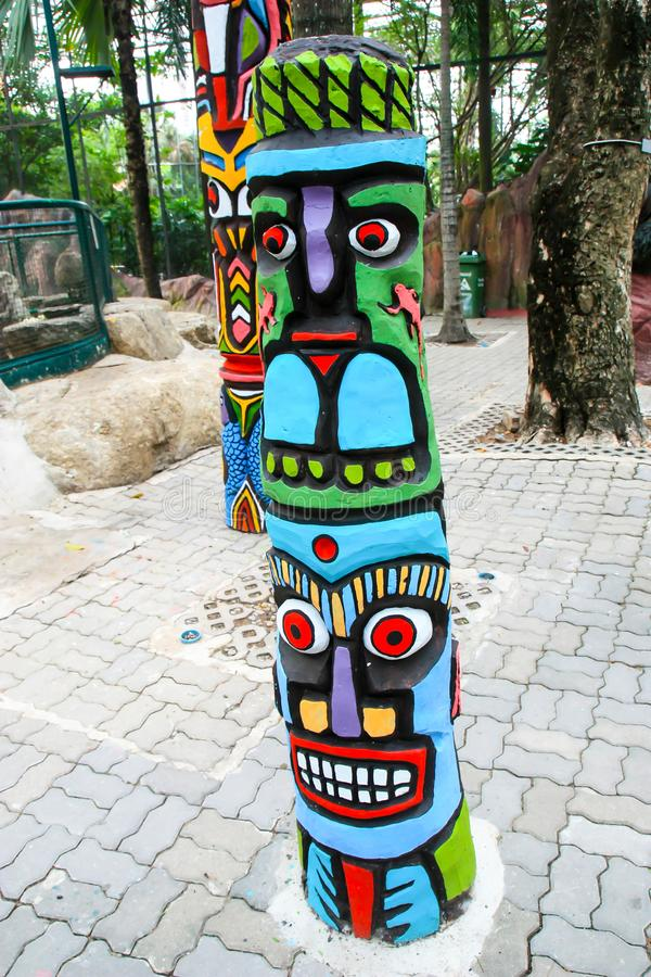 Ancient wooden carvings. The ancient tribal wood carvings are full of colorful colors stock photography