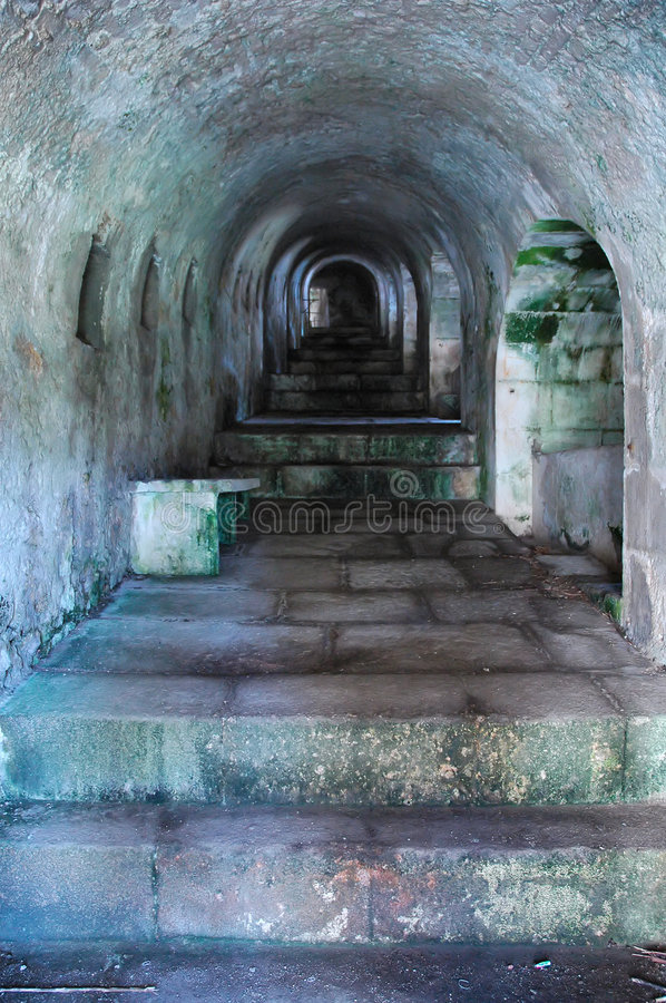 Ancient tunnel with stairs royalty free stock photography