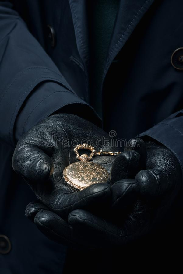 Ancient vintage gold watch in male hands royalty free stock photo