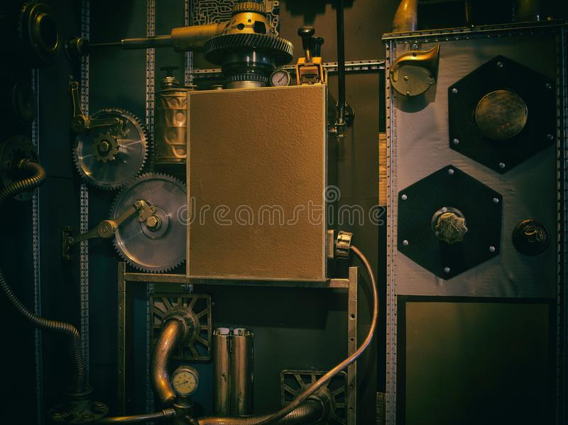 An ancient vintage wall with mechanisms in the steampunk style. royalty free stock photo