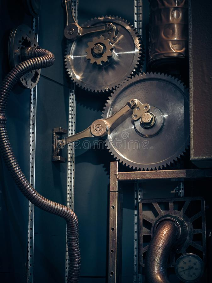 An ancient vintage wall with mechanisms in the steampunk style. stock image