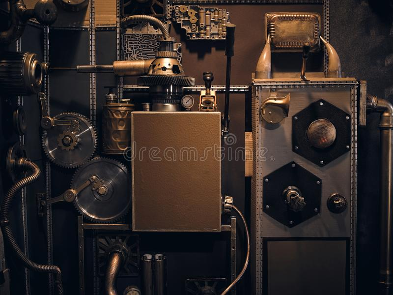 An ancient vintage wall with mechanisms in the steampunk style. stock photos