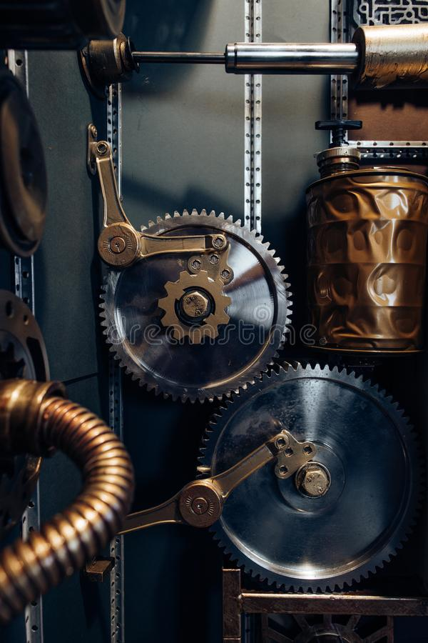 An ancient vintage wall with mechanisms in the steampunk style. stock photo