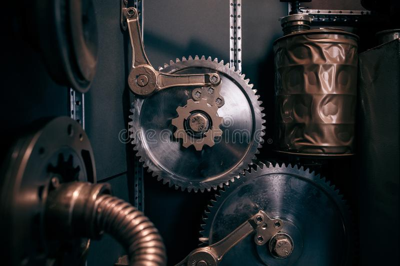 An ancient vintage wall with mechanisms in the steampunk style. royalty free stock images