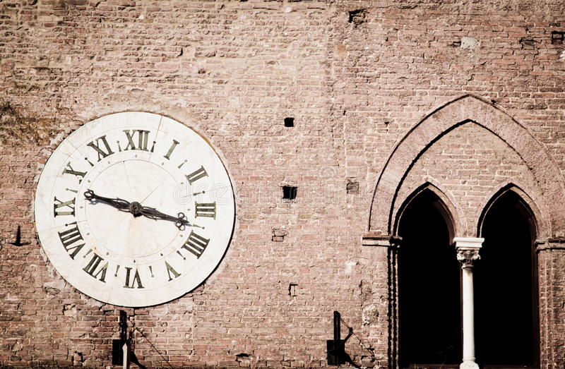 Download Ancient wall clock stock photo. Image of mullioned, distressed - 20212278