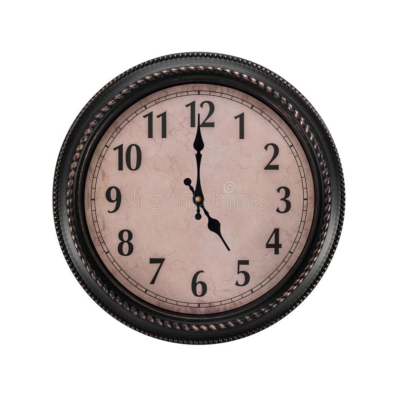 Ancient wall clock on a white background. Five o`clock in the afternoon or five in the morning on the clock royalty free stock photo