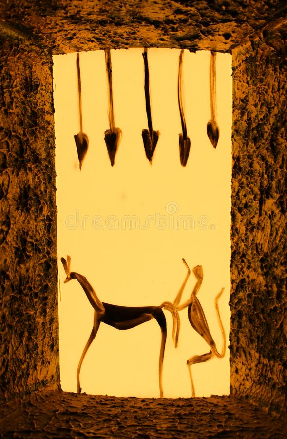 Ancient Wall decor. Frame with light settings, art of Spear and animals reveal the history of people royalty free stock photo