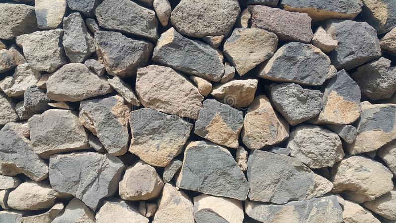 Ancient wall of natural stones, fence, stones laid and fixed without concrete. Very beautiful background stock image