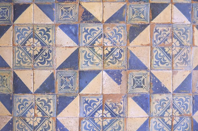 Ancient wall of patchwork pattern from colorful Moroccan, Portuguese tiles, Valencian, Tile, ornaments, Surface textures. royalty free stock photos