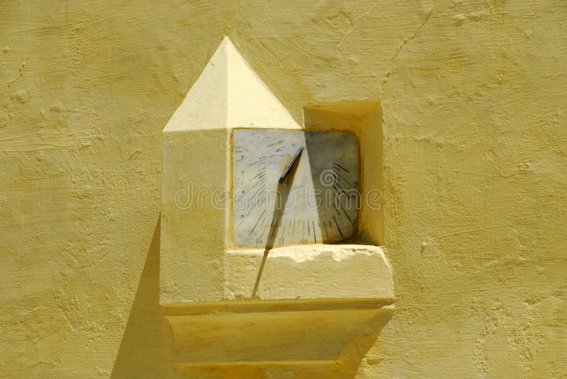 Ancient wall solar watch royalty free stock photo