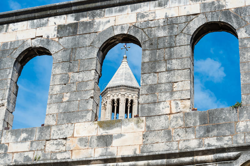 The ancient walls of Diocletian palace and church's tower, Croatia. royalty free stock photography