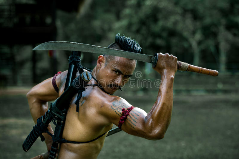 Ancient warrior man of soldier of Bang Rachan District Thailand. Hold sword ready fighter royalty free stock photography
