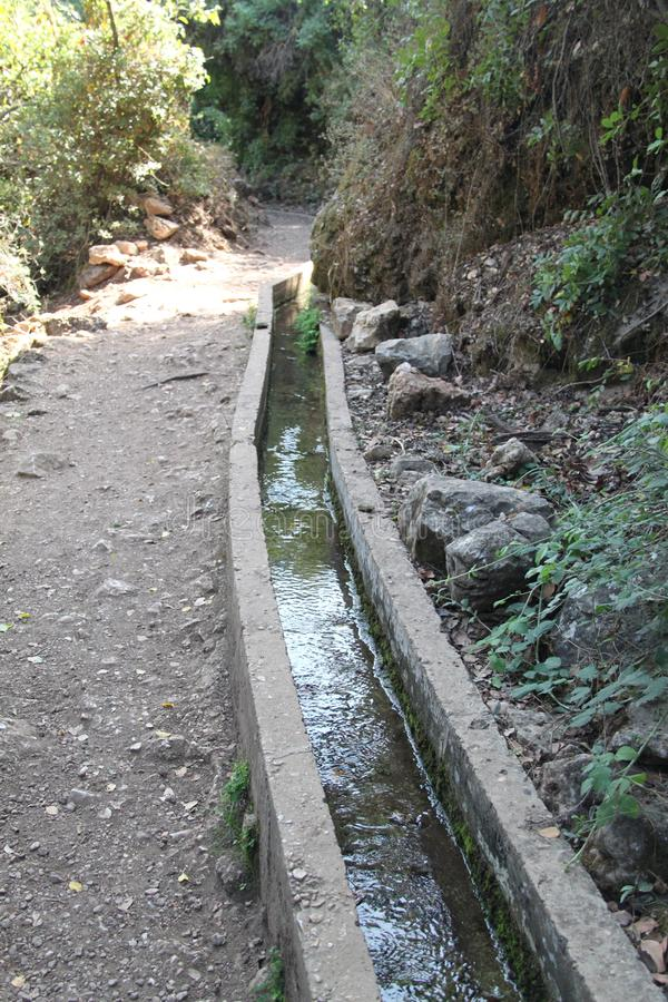 An Ancient Water Aqueduct. Made of concrete for loeading water from place to place royalty free stock photos