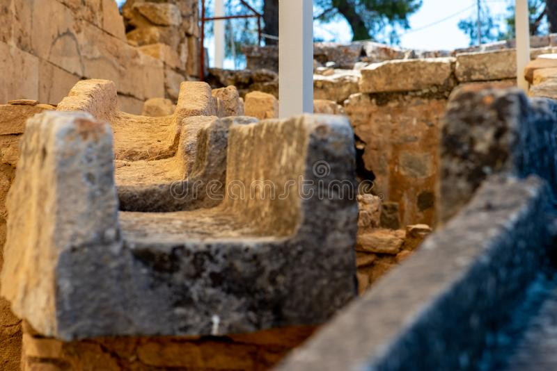 Ancient water pipe at historical excavation. In Phaistos on Crete royalty free stock image