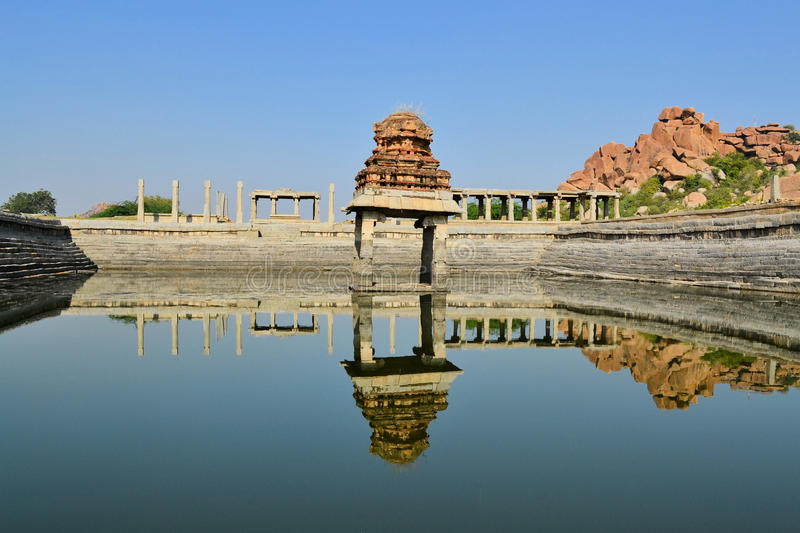 Ancient water pool in Hampi, India stock photography