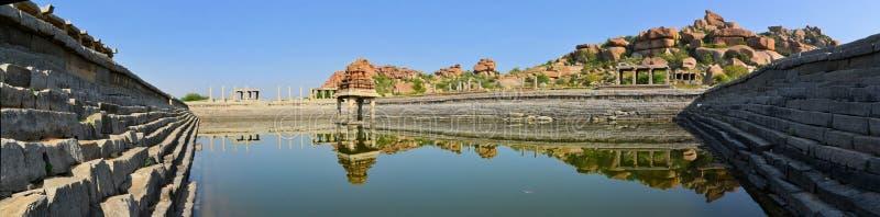Ancient water pool in Hampi, India. Ancient water pool and temple at Krishna market, Hampi, Karnataka state, India stock photography