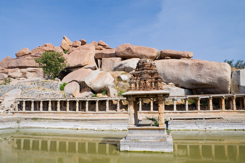 Ancient water pool and temple at Krishna market stock photography