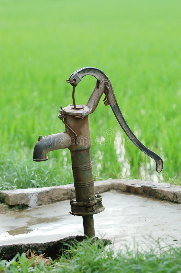 Ancient water pump. Photo of ancient water pump in padi field stock images