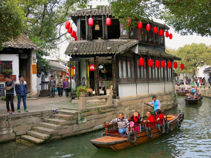 Ancient Water Town in China. Tongli, an ancient water town in Jiangsu, China, where tourists ride boats down canals on narrow streets stock image