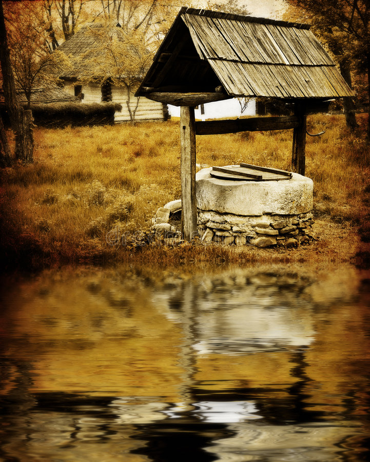 Ancient water well. Sepia image of ancient water well in rustic village stock photography