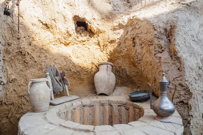 Ancient water well. In house of Central Asia royalty free stock images