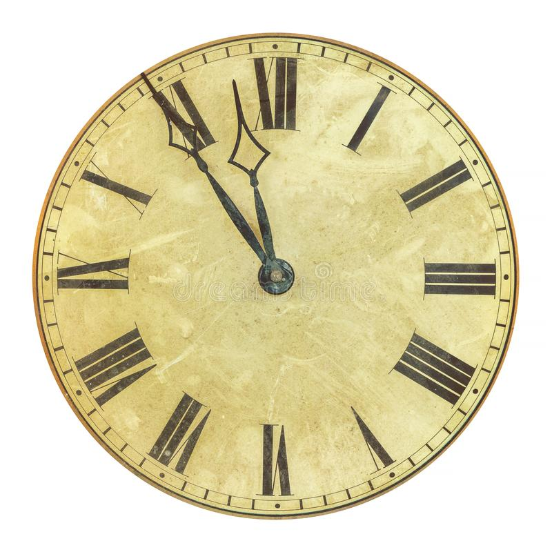 Ancient weathered clock face with the time five to twelve stock photography