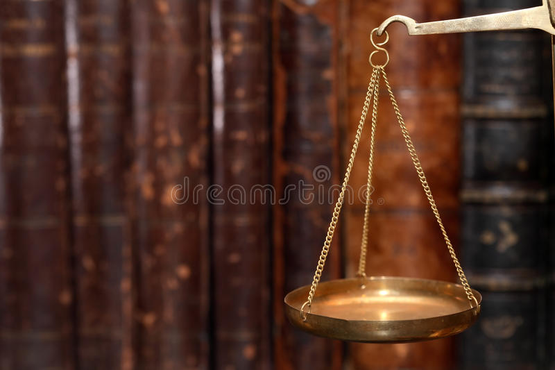 Ancient Weight Scales. Closeup of old brass weight scales on cover books background stock image