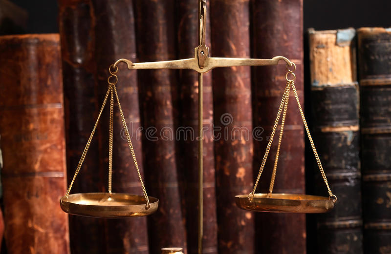 Ancient Weight Scales. Closeup of old brass weight scales on cover books background stock images