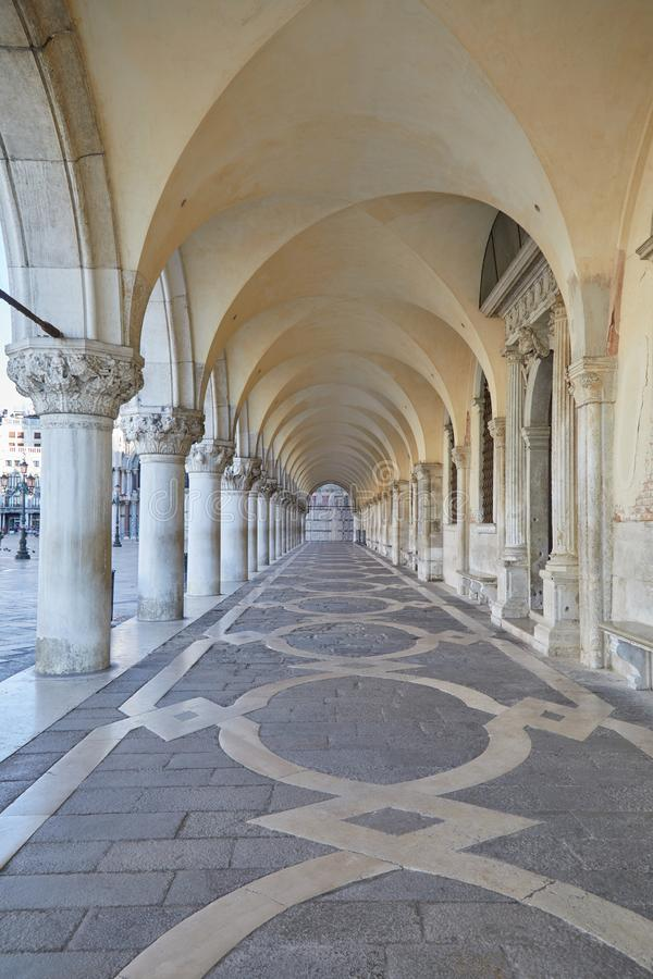 Ancient, white arcade in Venice, nobody in Venice. Ancient, white arcade in Venice, nobody in the early morning in Italy stock photo