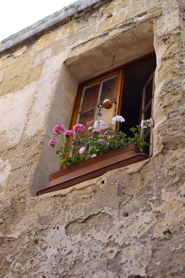 Ancient window. Antique window and balconies of a building in the classical style stock photo