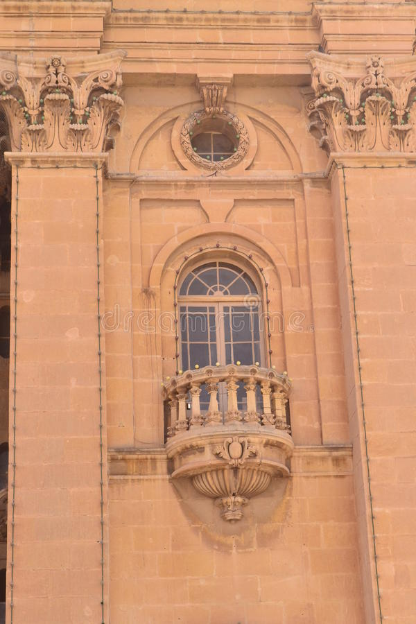 Ancient window. Antique window and balconies of a building in the classical style royalty free stock images