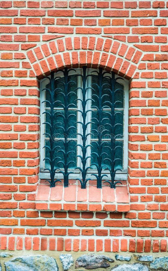 Old window with lattice and brick stones royalty free stock image