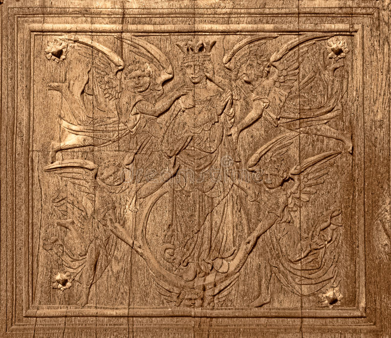 Ancient Wood Carving on Antique Church Old Door royalty free stock photo