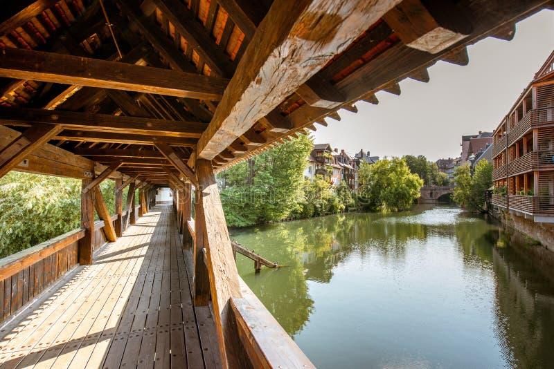 Ancient wooden bridge in Nurnberg, Germany. Morning view on the ancient wooden bridge on Pegnitz river in Nurnberg, Germany royalty free stock images