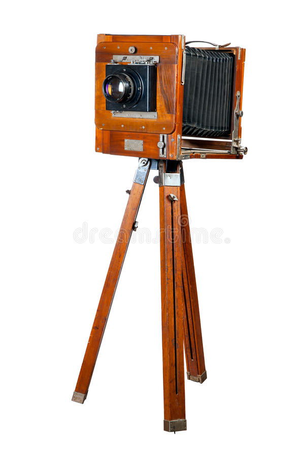 Ancient wooden camera. It is isolated on a white background stock image