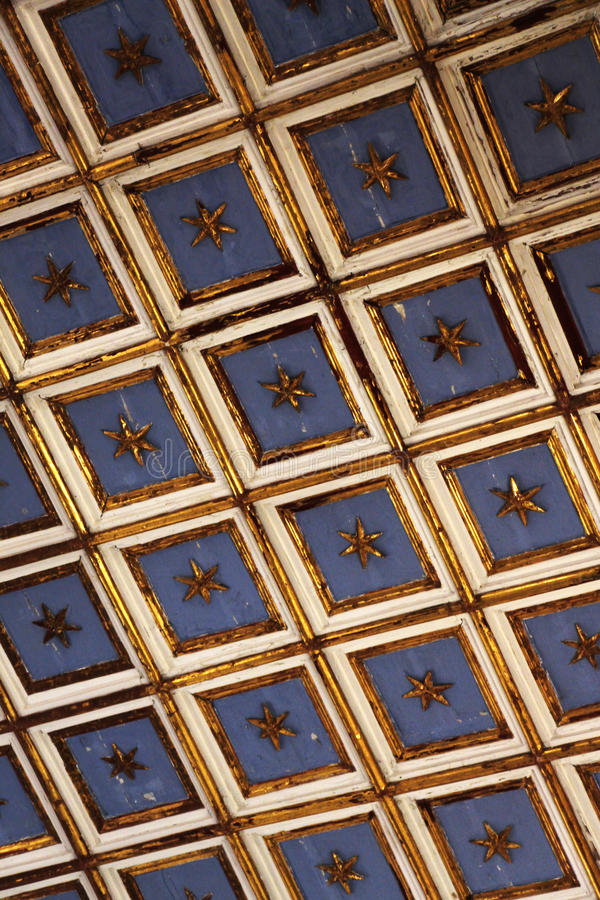 Ancient wooden ceiling, interior of a church. A detail of the ancient wooden ceiling, from the interior of the church of st margaret in sciacca, sicily, portrait royalty free stock image