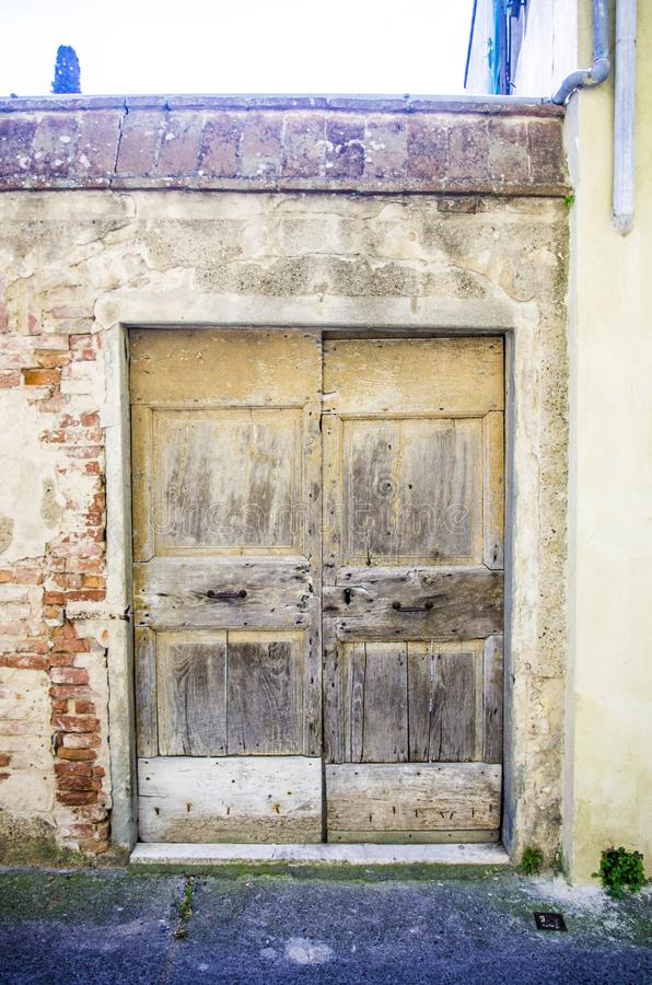 Gate with wooden door of ancient urban villa royalty free stock images