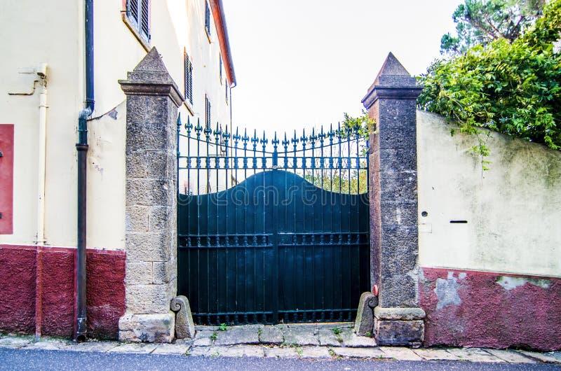 Gate with wooden door of ancient urban villa stock photos