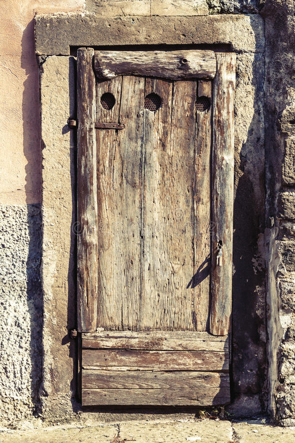 Ancient Wooden Door In Historical House Stone Frame Stock