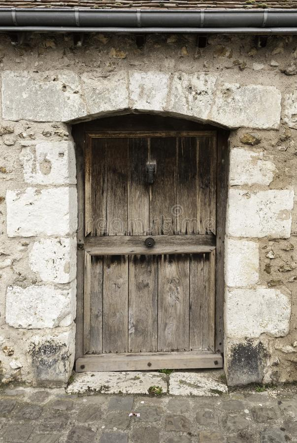 Ancient wooden doorway. Weathered old wooden doorway in a stone building royalty free stock photos