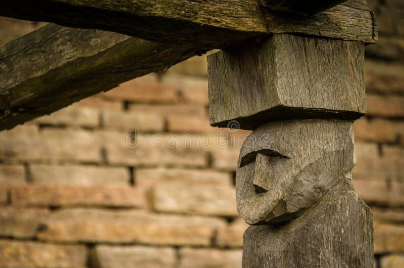 Ancient wooden face pillar, round fort Eketorp stock image